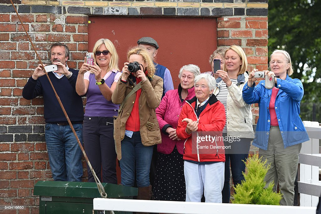 Crowds wait to catch a glimpse of Queen Elizabeth II & Prince Philip, Duke Of Edinburgh arriving on a steam train to open the new Bellarena Station village on June 28, 2016 in Bellarena, Northern Ireland.