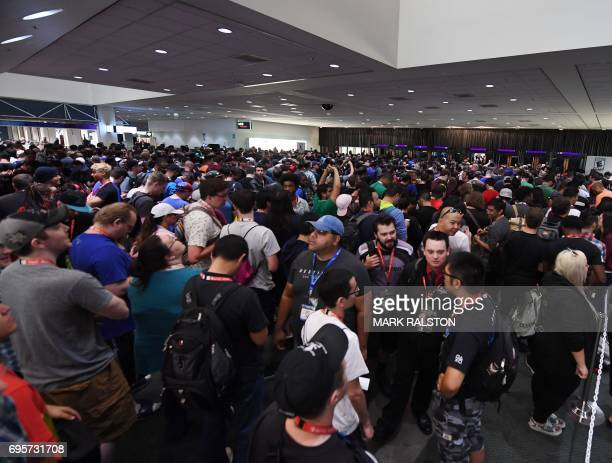 Crowds wait to enter the Los Angeles Convention center on day one of E3 2017 the three day Electronic Entertainment Expo one of the biggest events in...