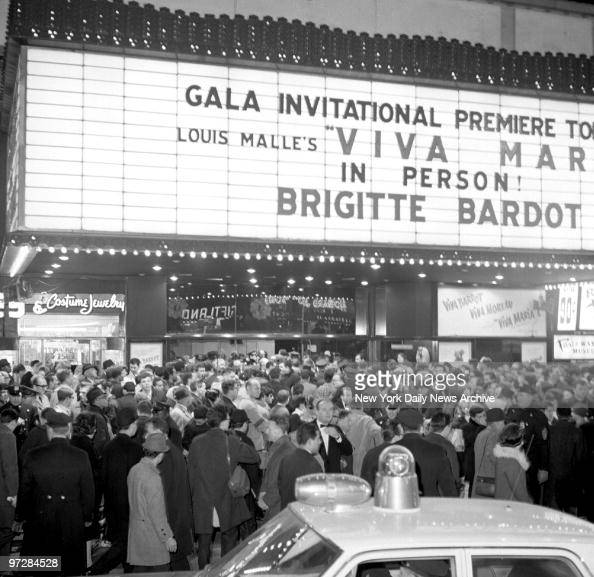 Crowds wait to see Brigitte Bardot who is arriving for the premiere of her movie ' Viva Mara'