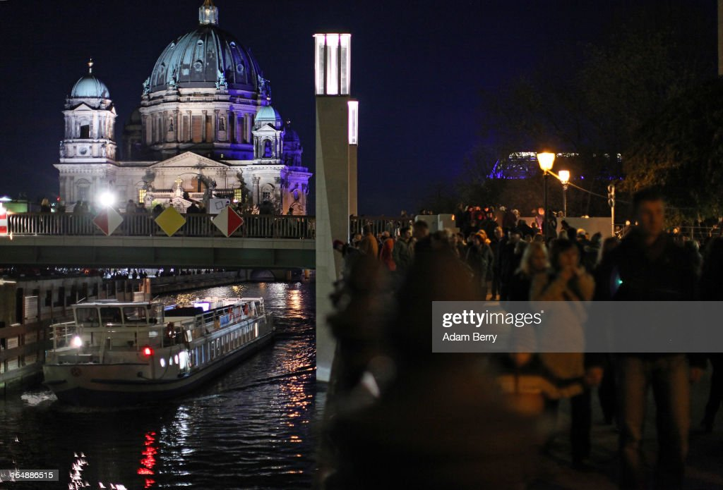 Crowds walk near the Berliner Dom (Berlin Cathedral) while walking towards a presentation by the French fire performers Carabosse as part of celebrations marking the 775th anniversary of the city of Berlin as a boat passes under a bridge on October 28, 2012 in Berlin, Germany. The settlement of Coelln, which stood opposite Berlin on the Spree river, is first referred to in a document from 1237, and by the beginning of the 14th century Coelln and Berlin joined together to become the region's most important trading center.