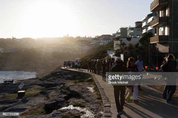 Crowds walk the coastal path at Tammaramma on the evening before the official opening of Sculpture By The Sea at Bondi Beach on October 18 2017 in...