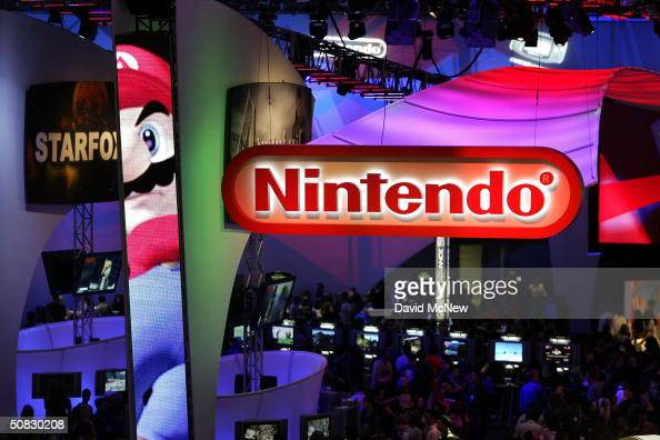 Crowds walk through the Nintendo exhibit on opening day of the 10th annual Electronic Entertainment Expo on May 12 2004 in Los Angeles California E3...