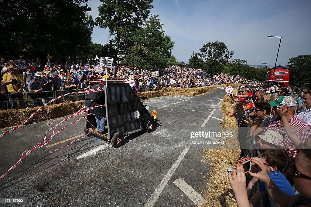 Crowds watch as a soapbox racer makes its way down the course during the Red Bull Soapbox Race at Alexandra Palace on July 14, 2013 in London, England. The Red Bull Soapbox Race returned to London after nine years and encourages competitors to build and race their own homemade soapboxes down a hill.