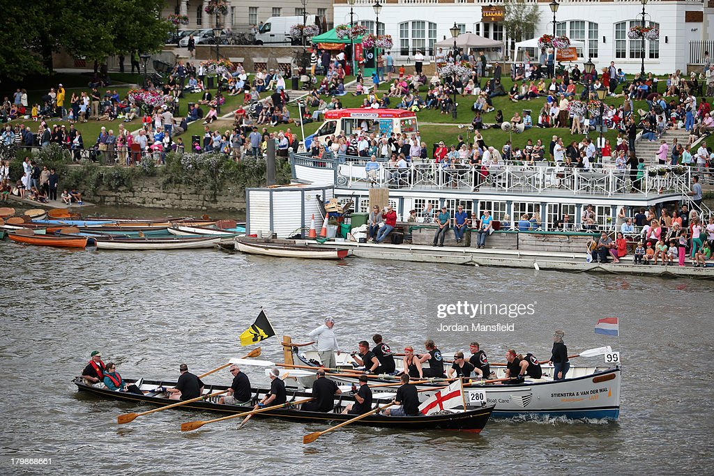 Crowds watch as crews compete in the annual 'Great River Race', a 22 mile rowing race on the River Thames from the Docklands to Richmond on September 7, 2013 in London, England. Over 300 crews, of varying ability and type of boat, competed in the event which has been running since 1988. Entrants are handicapped according to the calculated potential performance of their boat, with the fastest boats leaving last.