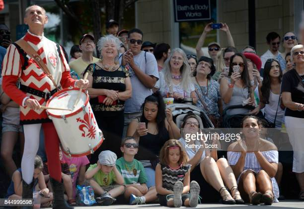 Crowds watch as members of the Sbandieratori dei Borghi e Sestieri Fiorentini perform their flag throwing act The group came all the way from...