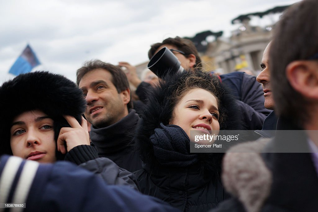 Crowds watch as Pope Francis appears in the window of his private residence in St Peter's Square to give his first Angelus blessing on March 17, 2013 in Vatican City, Vatican. The Vatican is preparing for the inauguration of Pope Francis on March 19, 2013 in St Peter's Square.
