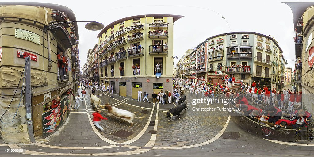 Crowds watch as runners avoid the bulls during the San Fermin Running Of The Bulls festival, on July 9, 2014 in Pamplona, Spain. The annual Fiesta de San Fermin, made famous by the 1926 novel of US writer Ernest Hemingway 'The Sun Also Rises', involves the running of the bulls through the historic heart of Pamplona,