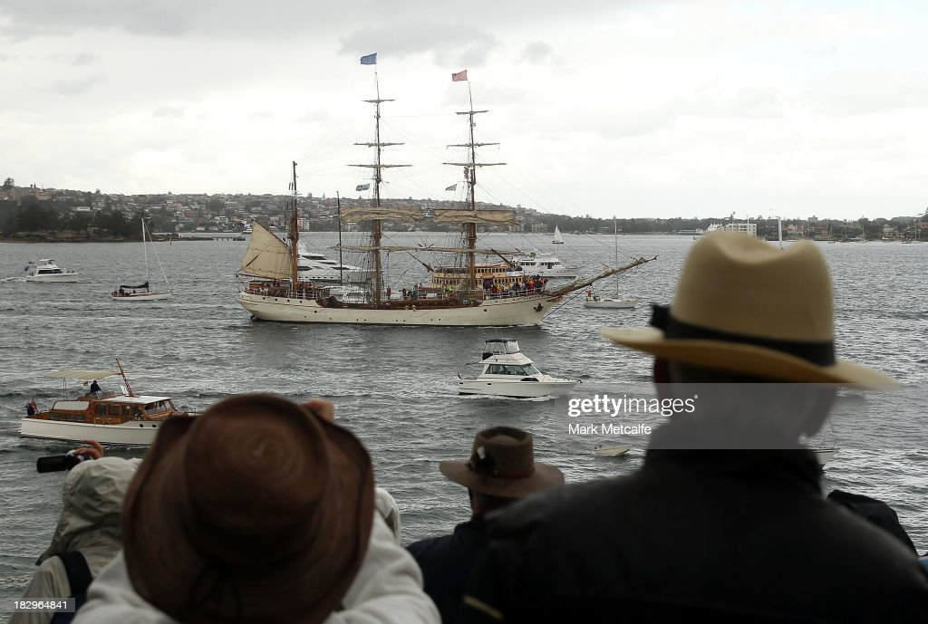 Crowds watch as Tall Ships enter Sydney Harbour on October 3, 2013 in Sydney, Australia. Over 50 ships will participate in the International Fleet Review at Sydney Harbour to commemorate the 100 year anniversary of the Royal Australian Navy's fleet arriving into Sydney. Prince Harry will take part in the fleet review during his two-day visit to Australia.