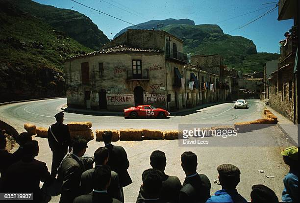 Crowds watch competitors in the 1965 Targa Florio as they race through the Sicilian village of Collesano