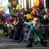 Crowds watch floats go by during the 74th Annual Macy's Thanksgiving Day Parade along Broadway November 23 2000 in New York City The thermometer read...