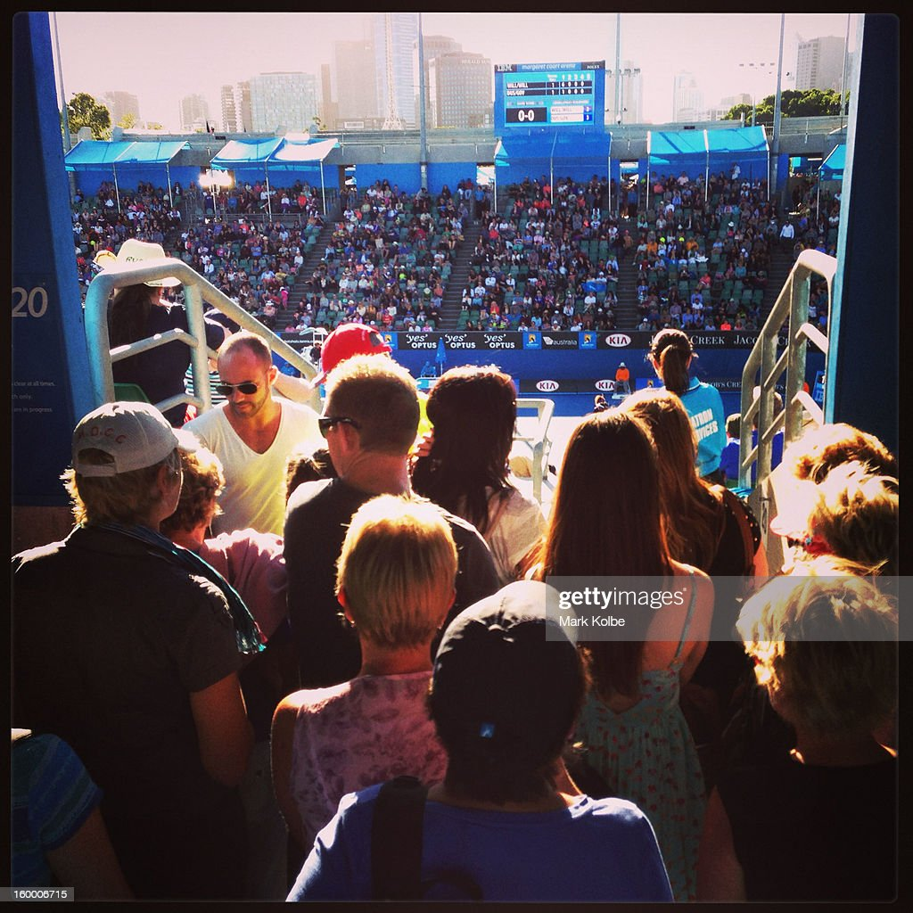 Crowds watch the action as they wait for seats on Magaret Court Arena during day six of the 2013 Australian Open at Melbourne Park on January 19, 2013 in Melbourne, Australia.