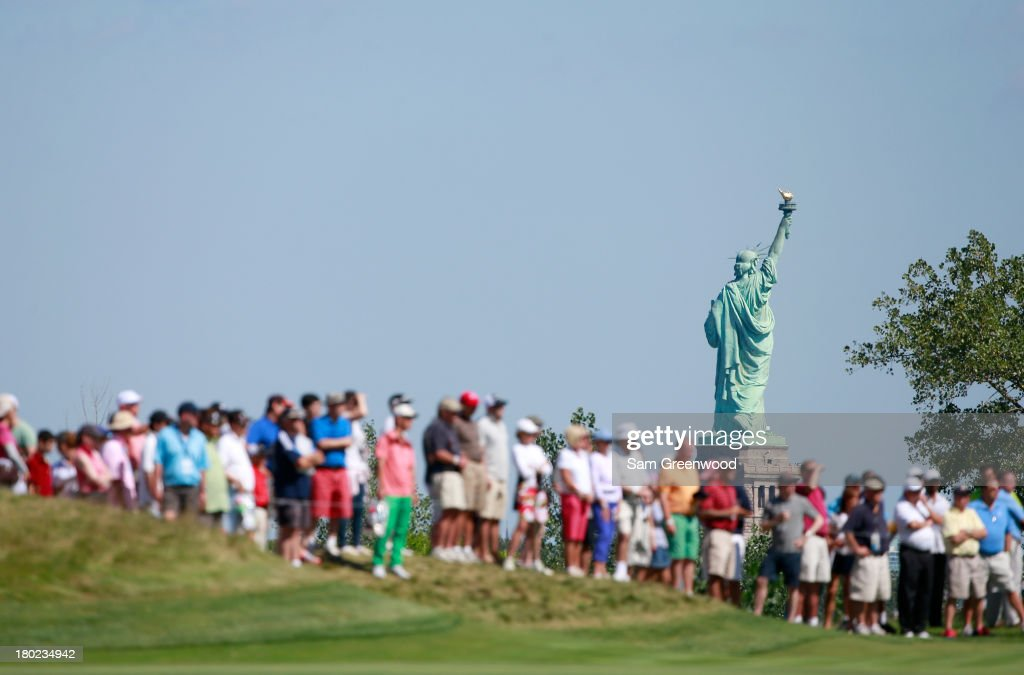 Crowds watch the action on the 17th hole during the third round of The Barlays at Liberty National Golf Club on August 24 2013 in Jersey City New...
