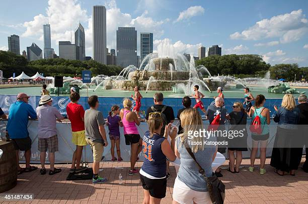 Crowds watch the world athletes participate in the Elite Men's race in the 2014 ITU World Triathlon Chicago in Grant Park on June 29 2014 in Chicago...