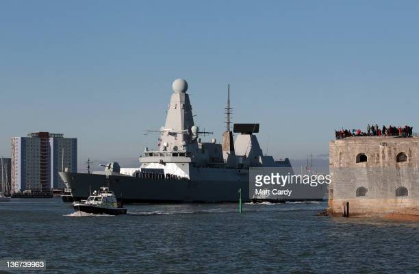 Crowds wave as HMS Daring the largest and most powerful destroyer warship ever built for the Royal Navy leaves Portsmouth Harbour on January 11 2012...