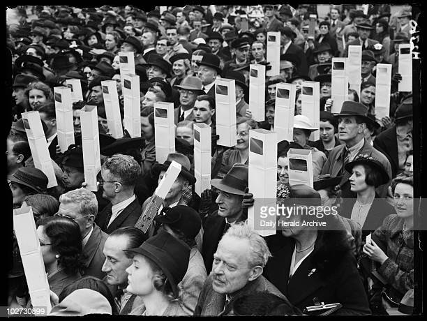 Crowds with periscopes in Trafalgar Square 1939 A photograph of crowds in Trafalgar Square watching for the arrival of King George VI and Queen...