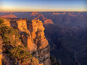 Crowed Mather Point at Grand Canyon south rim with a lot of people watching sunrise on a sunny moring in fall