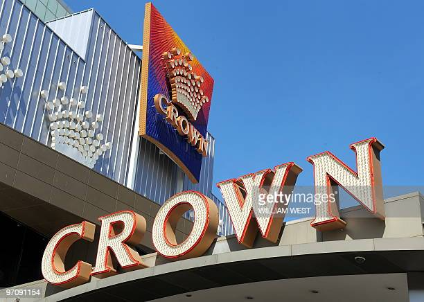 Crown Casino signs are displayed as Crown Ltd report they have moved back into the black with a net profit in their halfyear results after solid...
