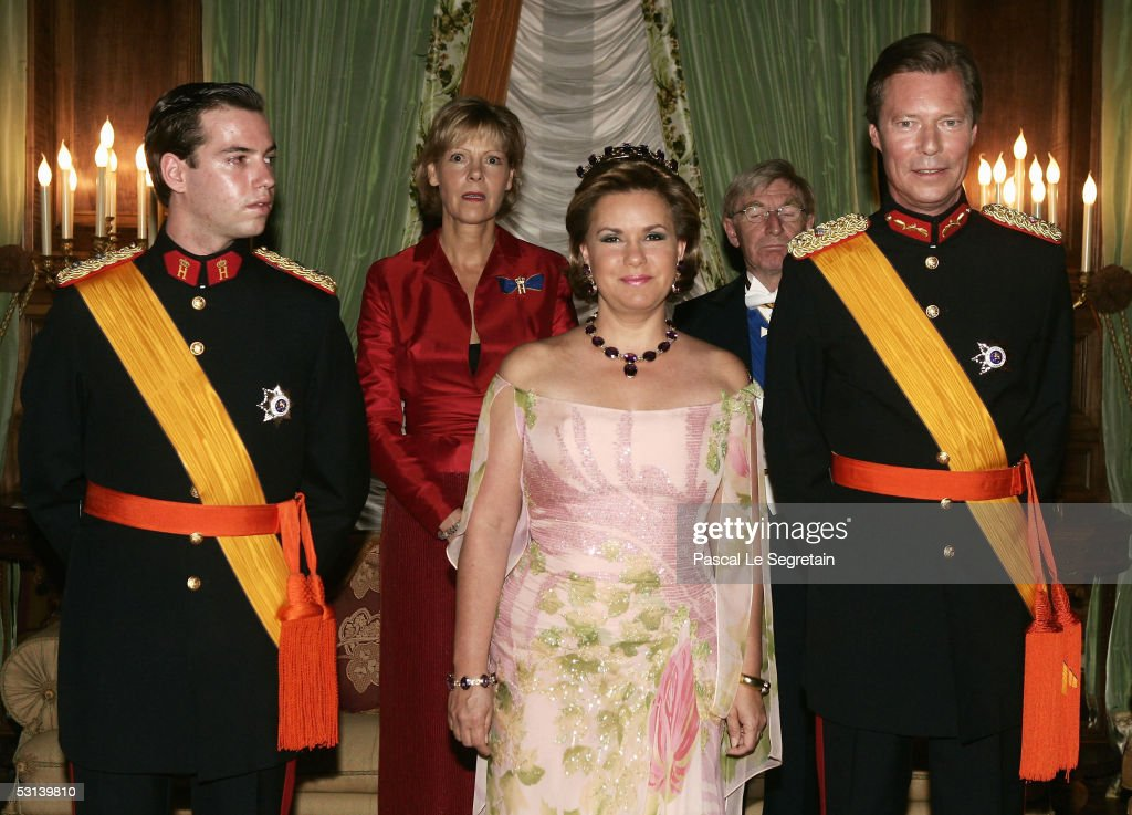 Crown Grand Duke Guillaume of Luxembourg, Grand Duchess Maria Theresa and Grand Duke Henri of Luxembourg attend a dinner at the Grand Ducal Palace as part of National Day celebrations June 23, 2005 in Luxembourg.