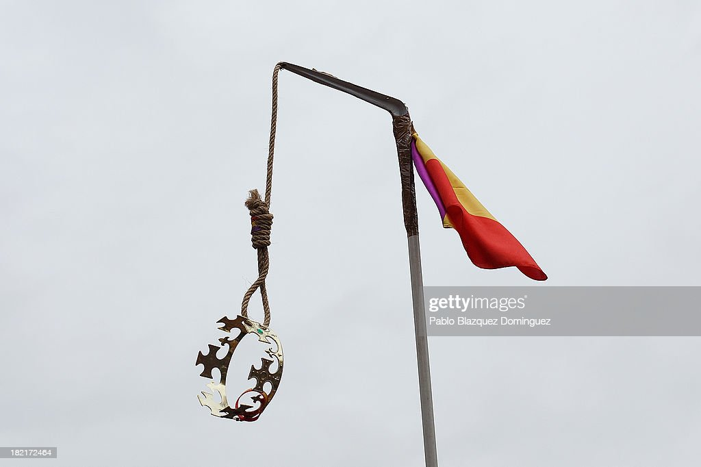 A crown hangs from a gallows adorned with the Republican flag during a demonstration against the Spanish Monarchy under the header 'Check the King' at Princesa Street on September 28, 2013 in Madrid, Spain. Organizers called for a demonstration on the anniversary of 'Surround the congress protest' to claim the abolition of the Monarchy. Currently King Juan Carlos of Spain is in hospital recovering from a hip operation. The Spanish Royal Family has lost popularity since the King injured his hip on an elephant hunting trip and the King's son-in-law, Inaki Urdangarin is being investigated over a corruption scandal.