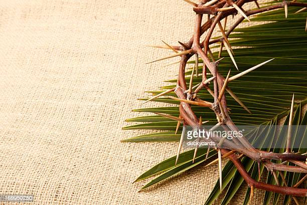 Crown of Thorns and Palm Leaf on Burlap Background