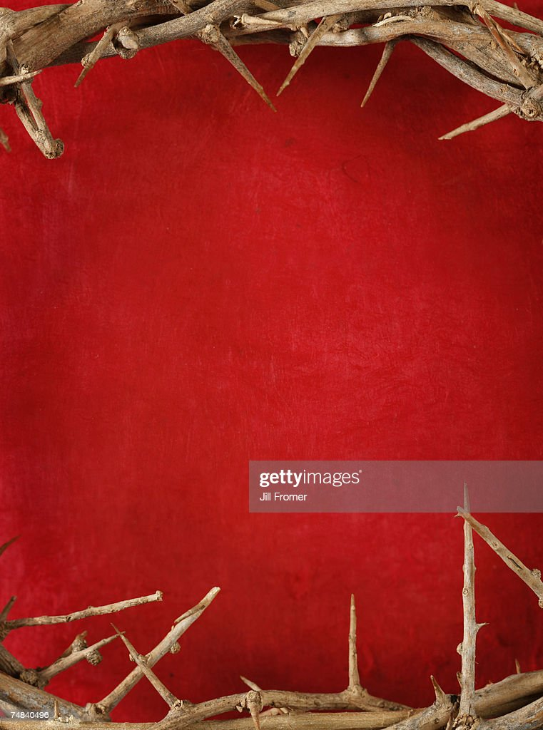 A crown of thorns on a red grunge background. : Stock Photo