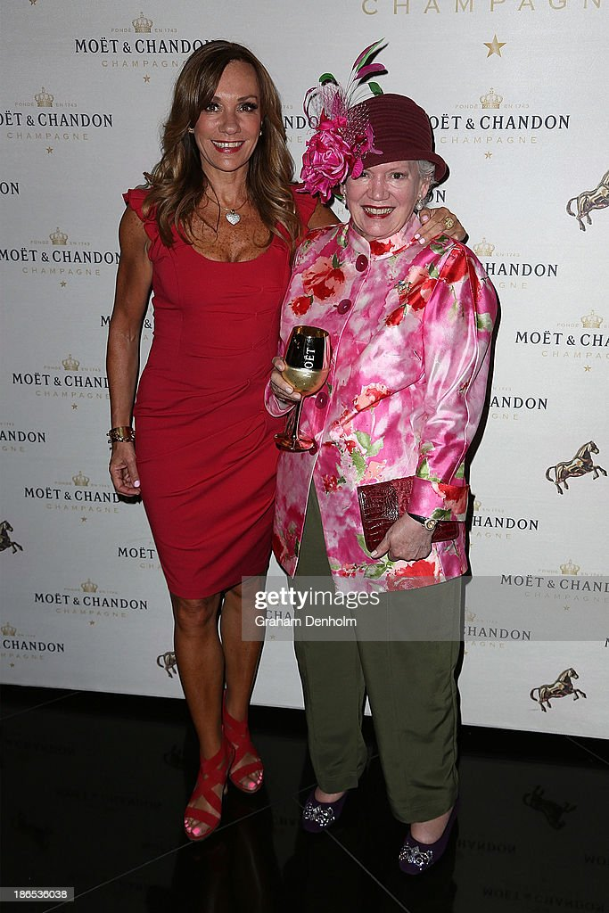 Crown PR Head Ann Peacock (L) and her mother Lady Susan Renouf pose at the Moet & Chandon Derby Eve party held at The Waiting Room, Crown Towers on November 1, 2013 in Melbourne, Australia.