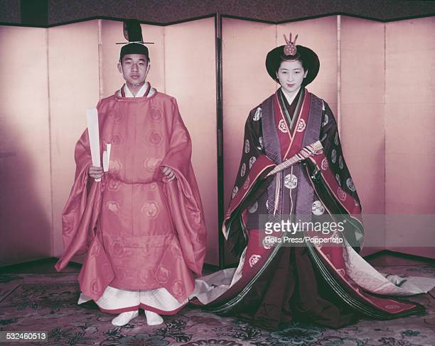 Crown Prince Akihito and Crown Princess Michiko of Japan pictured together wearing their traditional wedding attire of a sokutai for him and a...