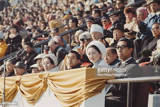 Crown Prince Akihito of Japan and Princess Michiko Shoda attend a winter sports event in the Makomanai Open Stadium in Sapporo Japan on 8th February...