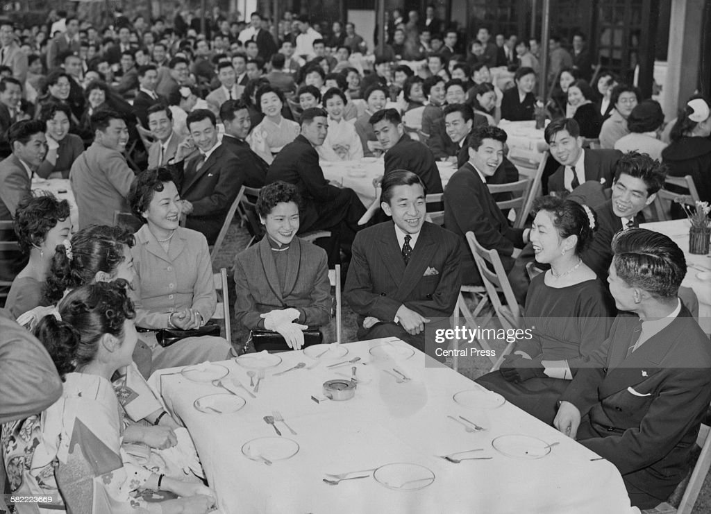 Crown Prince Akihito of Japan (centre) attends a farewell party held by the new graduates of Gakushuin University, Tokyo, Japan, April 1956. The Crown Prince had graduated from the university a month earlier.