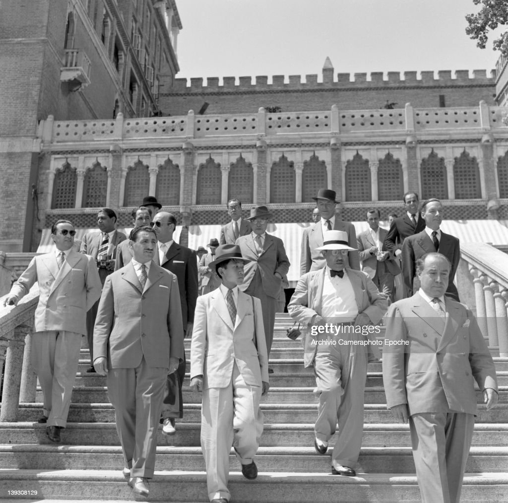 Crown Prince Akihito of Japan descending the steps of the Excelsior Hotel at the Lido Venice 1953