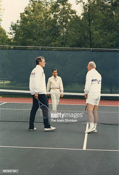 Crown Prince Akihito plays tennis with US Vice President George HW Bush and Secretary of States George Shultz at the official residence of the US...