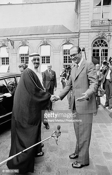 Crown Prince Fahd of Saudi Arabia shakes hands with French Prime Minister Jacques Chirac Prince Fahd made an official visit to France in 1975 the...
