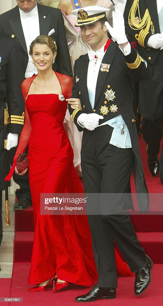 Crown Prince Felipe of Spain and fiancee Letizia Ortiz Rocasolano leave Copenhagen Cathedral after the wedding ceremony between Danish Crown Prince Frederik and his bride Crown Princess Mary on May 14, 2004 in Copenhagen, Denmark. The romance began in 2000 when Miss Mary Elizabeth Donaldson met the heir to one of Europe's oldest monarchies over drinks at the Sydney Olympics, where he was with the Danish sailing team.