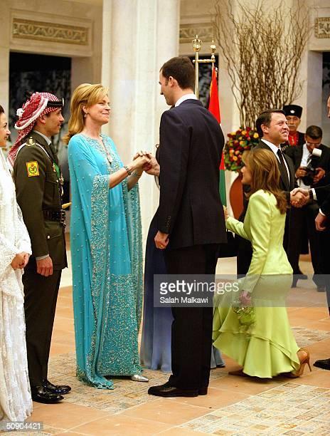 Crown Prince Felipe of Spain and his wife Princess Letizia congratulate Prince Hamzeh's mother Queen Noor as Crown Prince Hamzeh of Jordan and his...