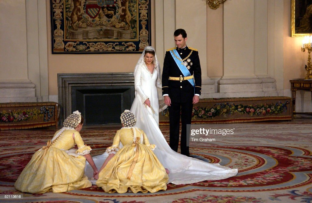 Crown Prince Felipe Of Spain, Prince Of The Asturias, With His Bride Crown Princess Letizia In The Royal Palace And Her Bridesmaids Attending To Her Dress.