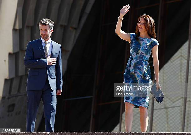 Crown Prince Frederick looks on as Crown Princess Mary of Denmark waves to the crowd on the Opera House forecourt on October 24 2013 in Sydney...