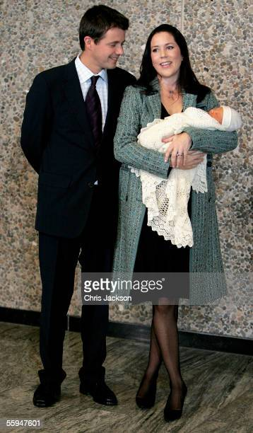 Crown Prince Frederik and Crown Princess Mary Donaldson pose with their new baby son as they leave Copenhagen University Hospital on October 18 2005...