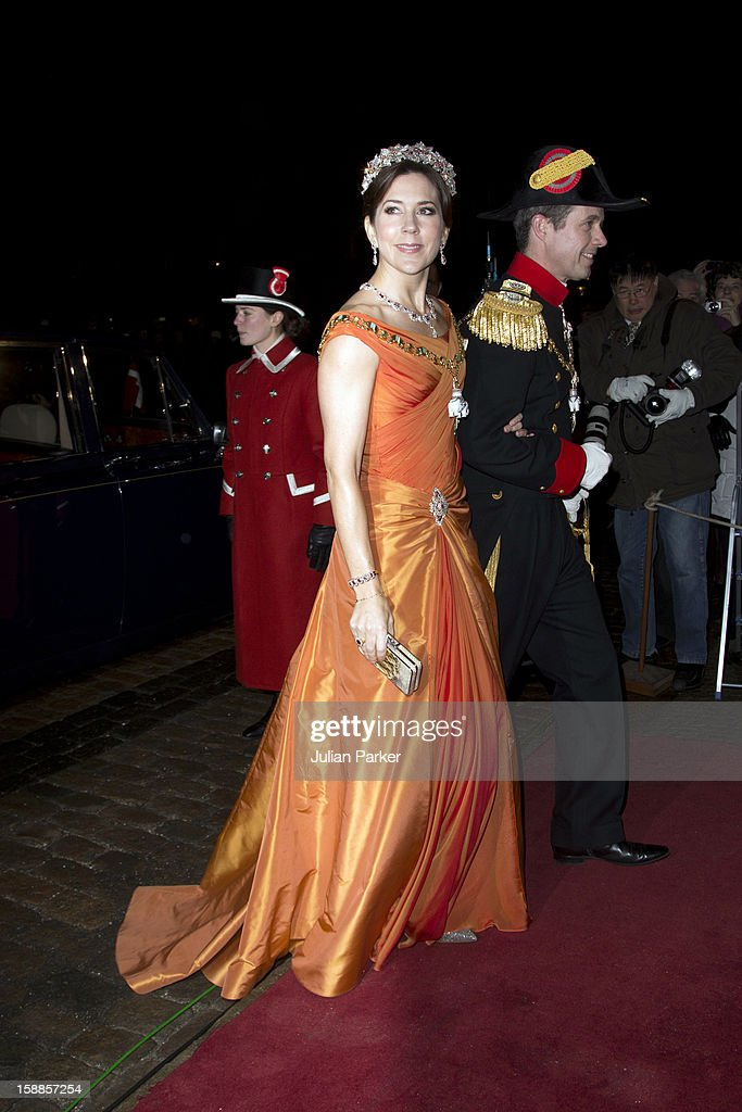 Crown Prince Frederik, and <a gi-track='captionPersonalityLinkClicked' href=/galleries/search?phrase=Crown+Princess+Mary+of+Denmark&family=editorial&specificpeople=158374 ng-click='$event.stopPropagation()'>Crown Princess Mary of Denmark</a> arrive at a New Year's Banquet hosted by Queen Margrethe of Denmark, at Christian VII's Palace, Amalienborg Palace on January 1, 2013 in Copenhagen, Denmark.