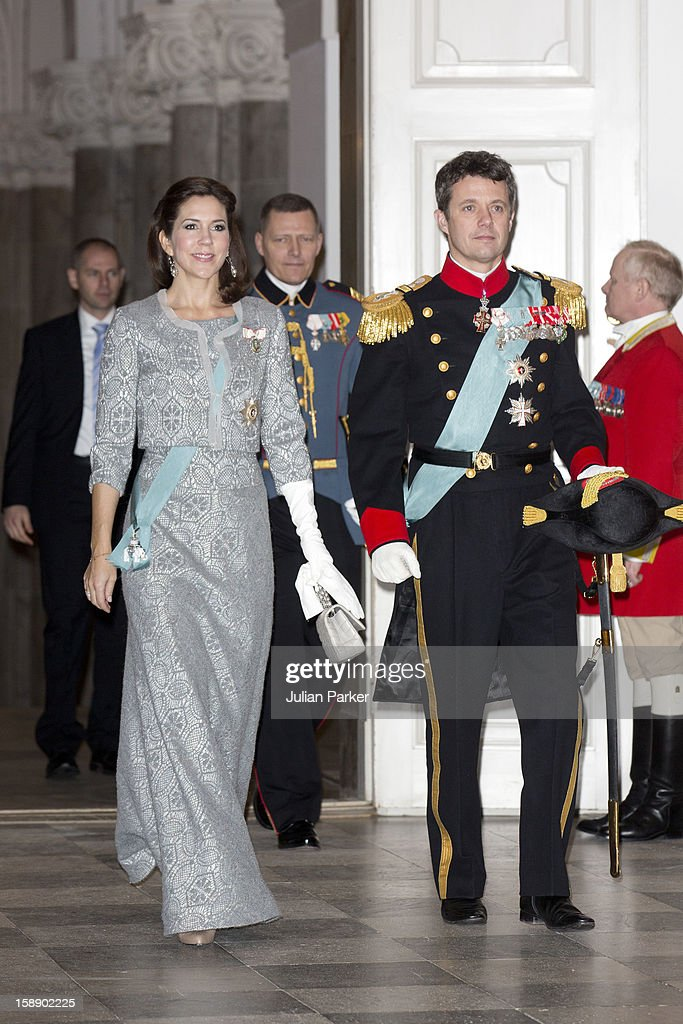 Crown Prince Frederik, and <a gi-track='captionPersonalityLinkClicked' href=/galleries/search?phrase=Crown+Princess+Mary+of+Denmark&family=editorial&specificpeople=158374 ng-click='$event.stopPropagation()'>Crown Princess Mary of Denmark</a> attend a New Year's Levee held by Queen Margrethe of Denmark, for Diplomats,at Christiansborg Palace on January 3, 2013 in Copenhagen, Denmark.