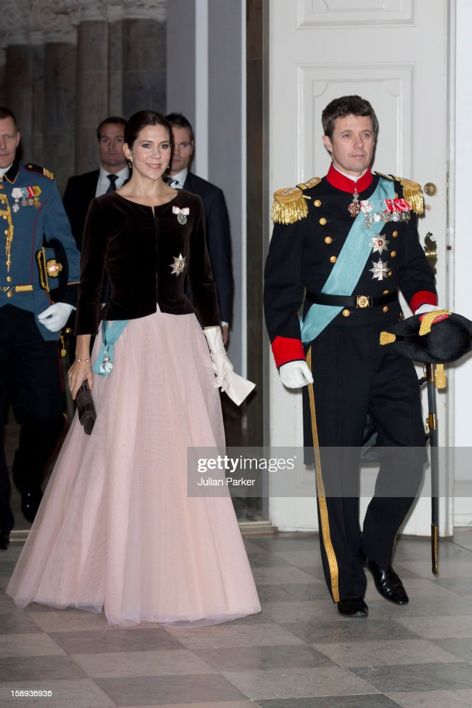 Crown Prince Frederik, and <a gi-track='captionPersonalityLinkClicked' href=/galleries/search?phrase=Crown+Princess+Mary+of+Denmark&family=editorial&specificpeople=158374 ng-click='$event.stopPropagation()'>Crown Princess Mary of Denmark</a> attend a New Year's Levee, for officers from the Defence and Danish Emergency management agency, and representatives from large national organizations, held by Queen Margrethe of Denmark at Christiansborg Palace on January 4, 2013 in Copenhagen, Denmark.