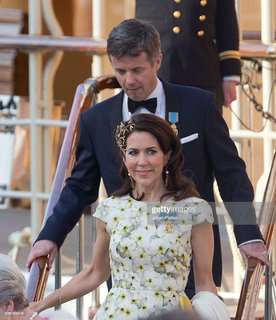 Crown Prince Frederik, and Crown Princess Mary of Denmark leave the Danish Royal Yacht, The Dannebrog, to attend the Banquet at The Royal Palace in Stockholm, on the occasion of King Carl Gustaf of Sweden's 70th Birthday, on April 30, 2016, in Stockholm, Sweden.