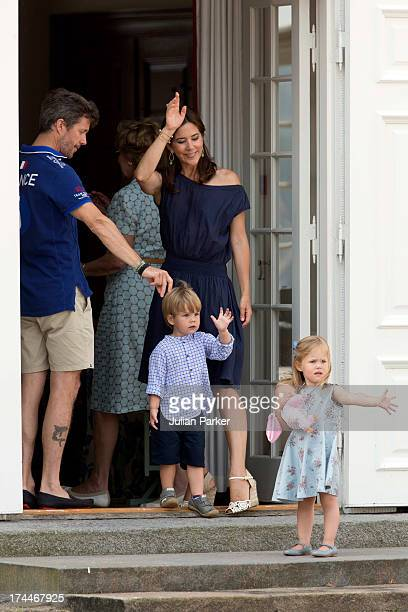 Crown Prince Frederik and Crown Princess Mary of Denmark with Prince Vincent and Princess Josephine watch the Guard change at Grasten Castle after...