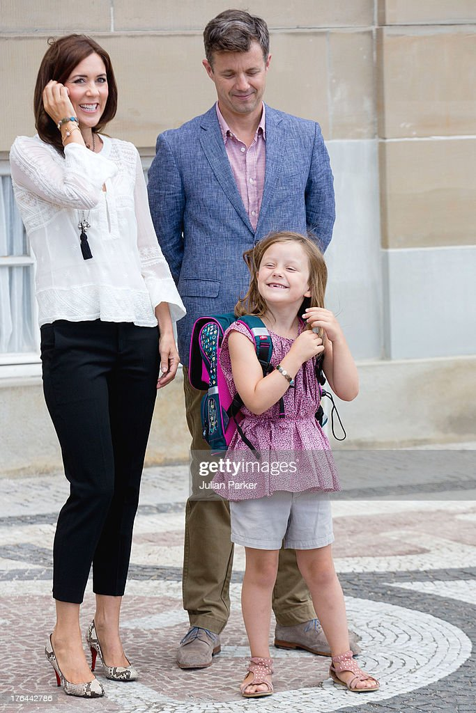 Crown Prince Frederik, and <a gi-track='captionPersonalityLinkClicked' href=/galleries/search?phrase=Crown+Princess+Mary+of+Denmark&family=editorial&specificpeople=158374 ng-click='$event.stopPropagation()'>Crown Princess Mary of Denmark</a>, with their daughter Princess Isabella depart Amalienborg Palace for Princess Isabella's first day at Tranegard School on August 13, 2013 in Copenhagen, Denmark.
