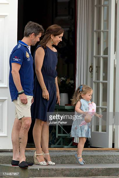 Crown Prince Frederik and Crown Princess Mary of Denmarkwith their daughter Princess Josephine of Denmark watch the changing of the Guard at Grasten...