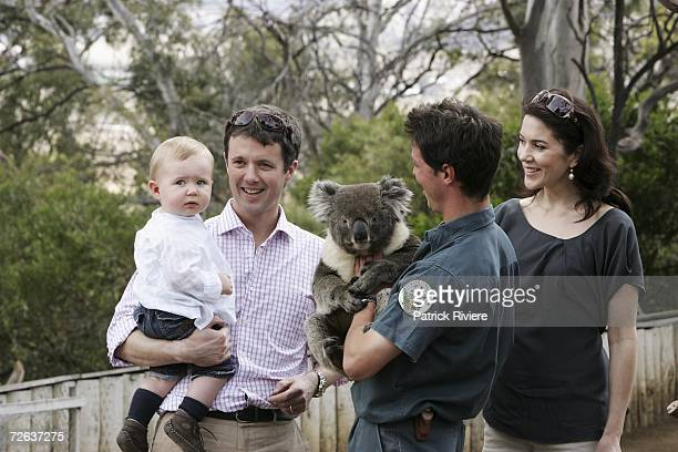 Crown Prince Frederik and pregnant Crown Princess Mary Of Denmark pose with their son Crown Prince Christian of Denmark with a koala at a photocall...