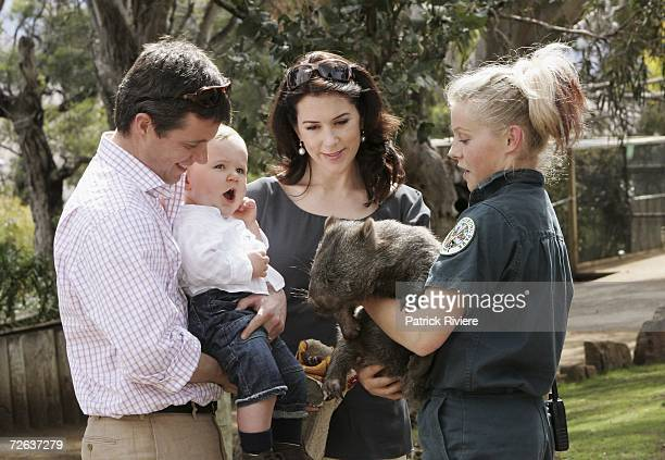 Crown Prince Frederik and pregnant Crown Princess Mary Of Denmark pose with their son Crown Prince Christian of Denmark with a wombat at a photocall...