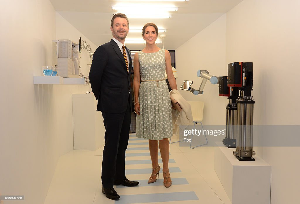 Crown Prince Frederik and Princess Mary of Denmark inspect a piece by artist Kristine Tilge Lund and architect David Garcia during the official opening of 'Danish Design at the House' at the Sydney Opera House on October 25, 2013 in Sydney, Australia. Prince Frederik and Princess Mary are visiting Sydney for five days and will attend events to celebrate the 40th anniversary of the Sydney Opera House and the Danish architect who designed the landmark, Jorn Utzen.