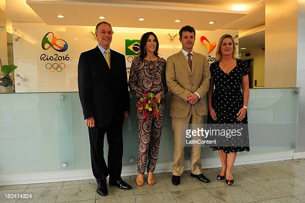 Crown Prince Frederik and Princess Mary of Denmark pose for a picture with Carlos Arthur Nuzman and his wife Marcia Peltier during their meeting with...