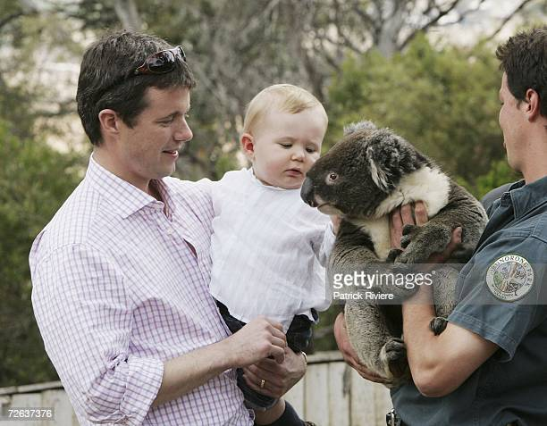 Crown Prince Frederik his son Crown Prince Christian of Denmark pose with a koala at a photo call held at Bonorong Park Wildlife Centre at the start...