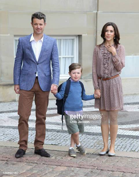 Crown Prince Frederik of Denmark and Crown Princess Mary of Denmark pose for photographs with their son Prince Christian of Denmark on his first day...